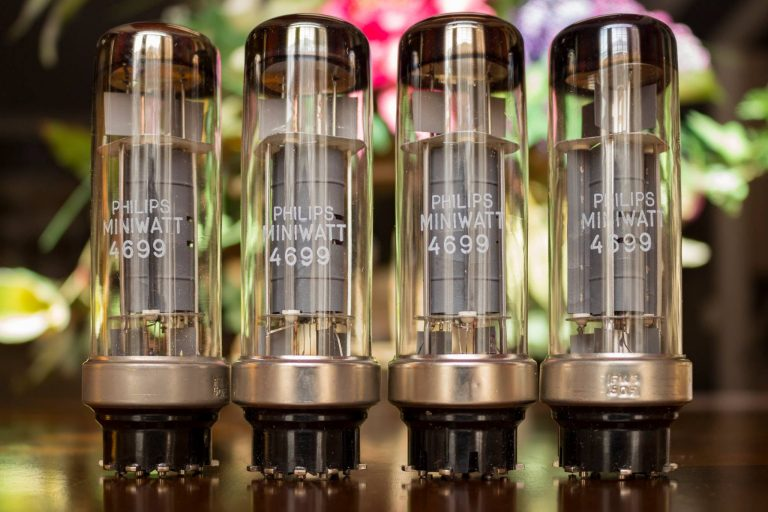Photo of Four Philips Miniwatt 4699 Power Vacuum Tubes on a table