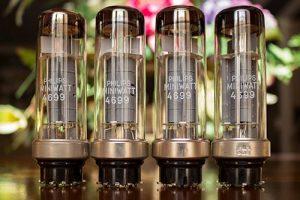 Photo of Four Philips Miniwatt 4699 Power Vacuum Tubes on a table